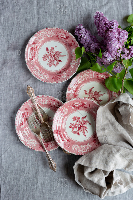 Red dessert plates with lilacs
