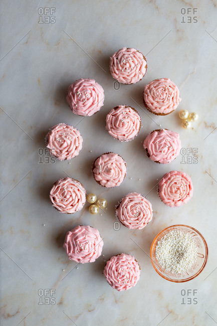 Pink cupcakes with pearls and decorations