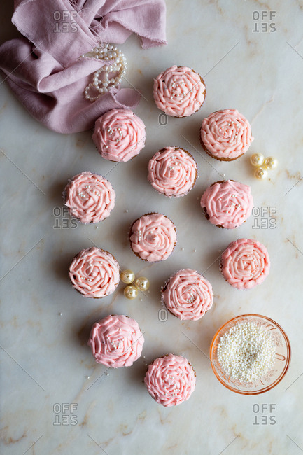 Light pink cupcakes with pearl decorations