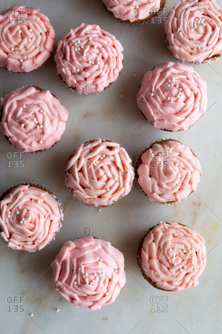 Pink cupcakes on marble background
