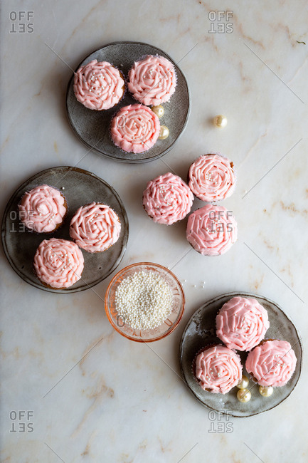 Light pink cupcakes on marble with pearls