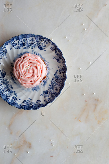 Light pink cupcake on marble background