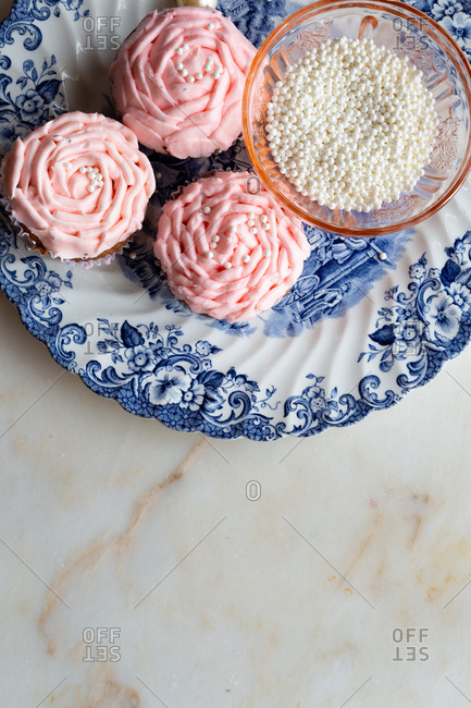 Light pink cupcakes with decorations