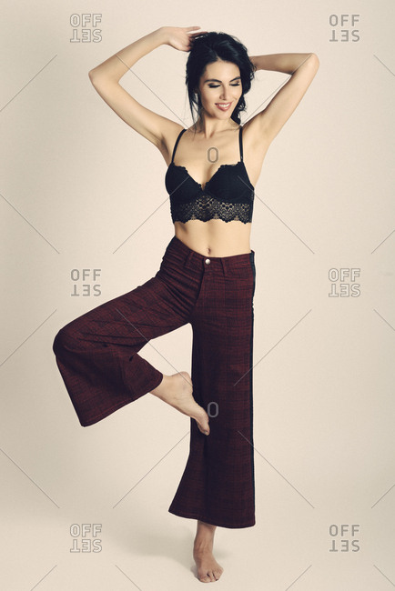 Woman wearing modern trousers and elegant black bra