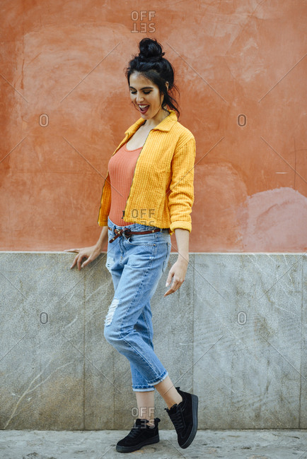 Woman wearing orange and blue casual clothes