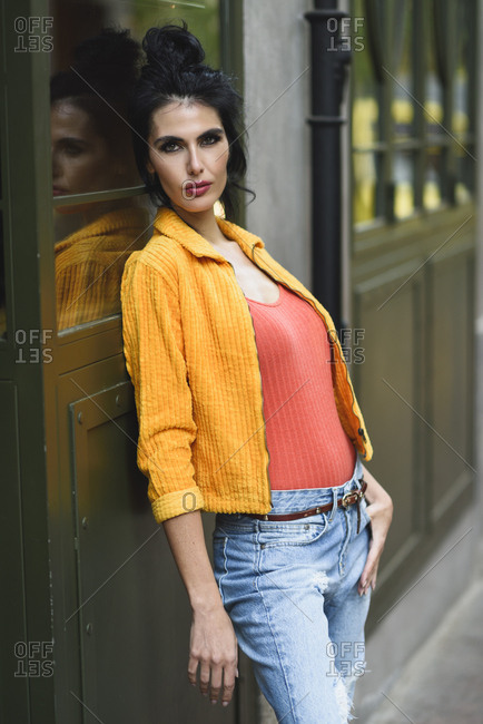 Fashionable woman wearing casual clothes standing in urban background