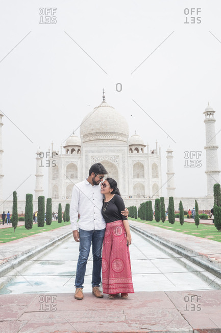 Couple in front of the Taj Mahal