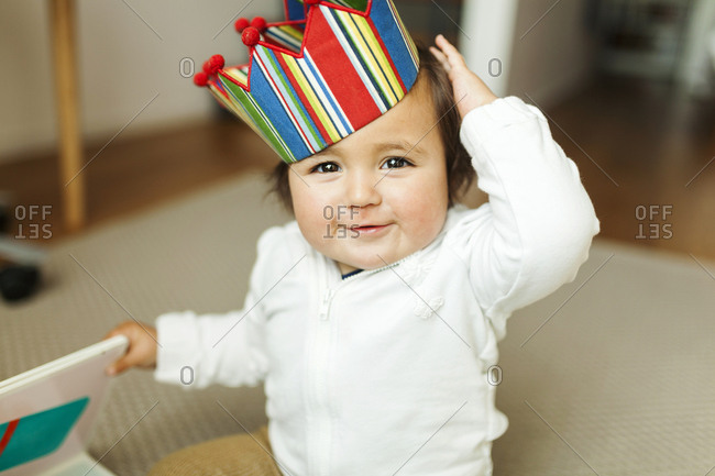 Portrait of a baby wearing a crown