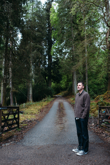 Man standing by a trail in Scotland