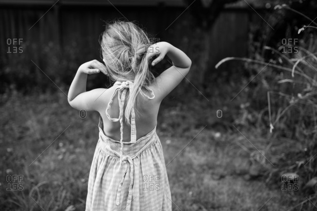 Rear view image of girl wearing summer dress in black and white