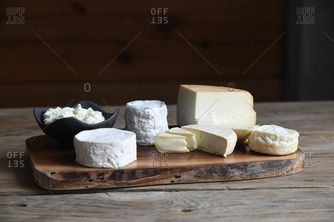 Variety of cheese on a wooden board