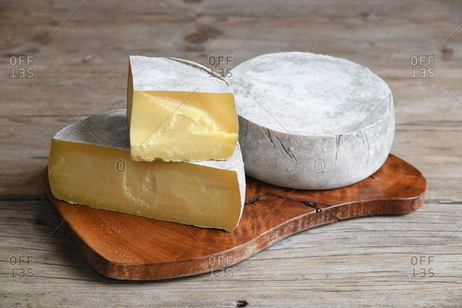 Cheese wheels on a wooden board