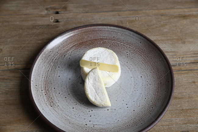 Overhead view of cheese on a round plate