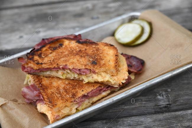 Reuben sandwich and pickles