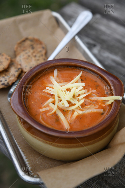 Tomato soup topped with cheese