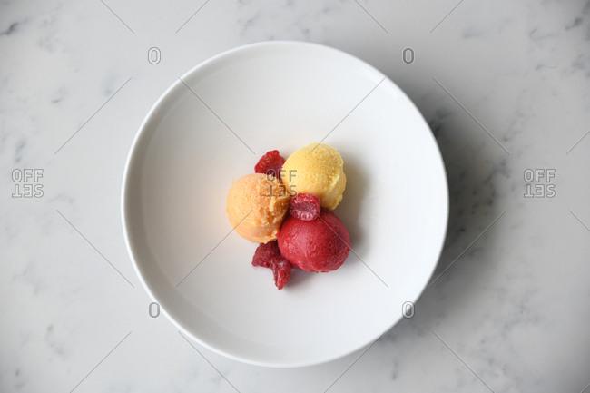 Three scoops of fruit sorbet