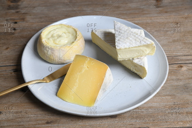 Overhead view of a variety of cheese on a platter