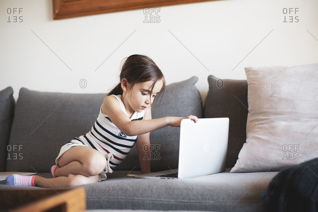 Girl on sofa with laptop