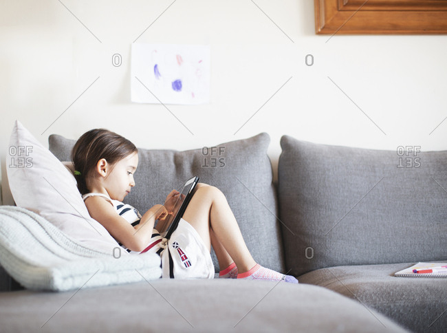 Girl on couch with tablet