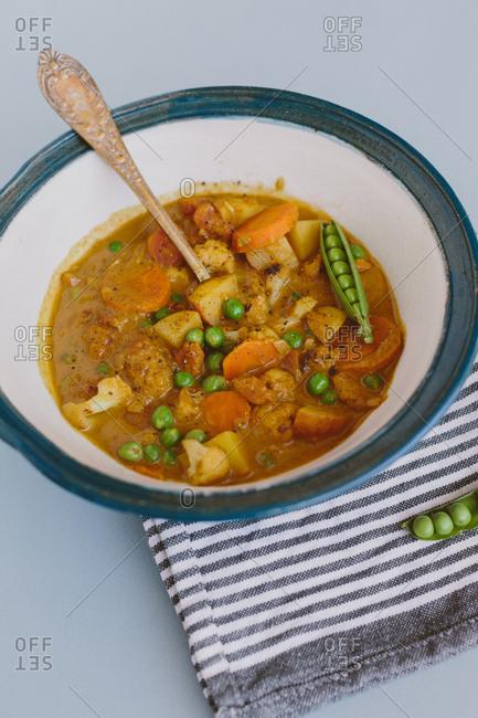 Close up of pea, cauliflower, coconut vegan curry