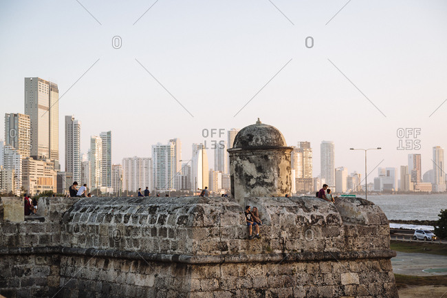 Cartagena de Indias, Colombia - February 7, 2018: The historic bastion city walls, Baluarte de Santo Domingo,  with the new buildings of Bocagrande in the background