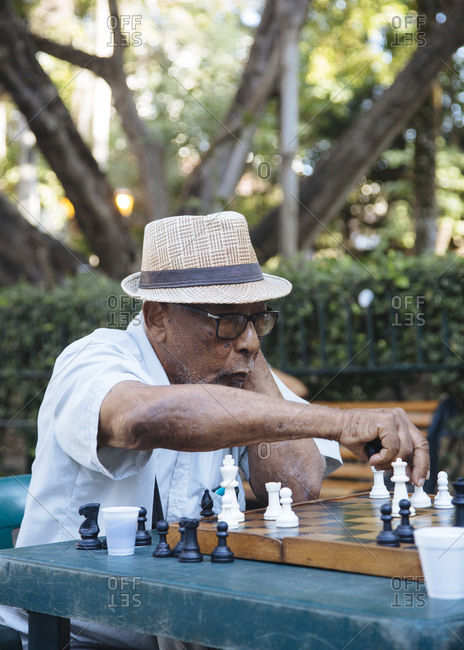 Cartagena de Indias, Colombia - February 10, 2018: Man playing chess at Plaza Bolivar, Cartagena de Indias, Colombia