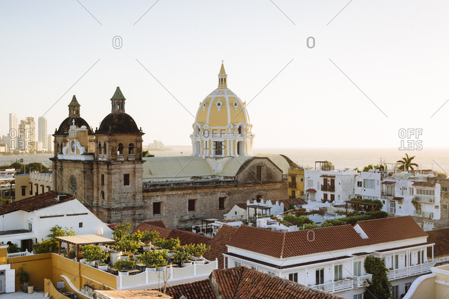 Skyline of Cartagena de Indias, Colombia with the Church of San Pedro Claver and Monastery and the modern building of Bocagrande in the background