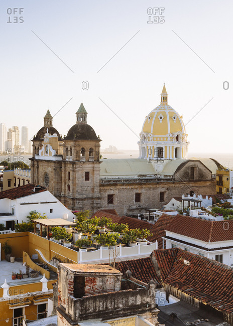 Skyline of Cartagena with the Church of San Pedro Claver and Monastery and the modern building of Bocagrande in the background, Colombia