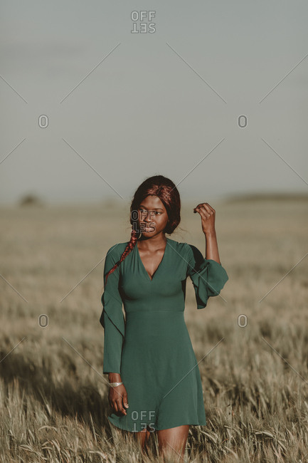 Young model with braided hair in meadow
