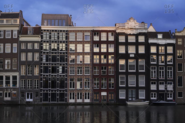 Amsterdam, Netherlands - May 22, 2018: Old-fashioned canal-front housing exterior