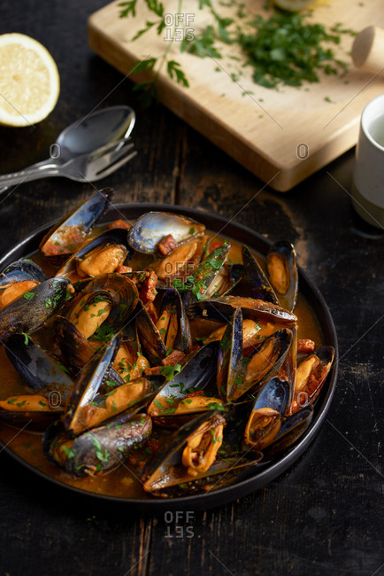 Tray of mussels in spicy tomato sauce on kitchen counter