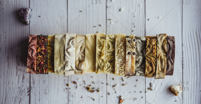 Alternating colors and textures of waxy soap across picnic table