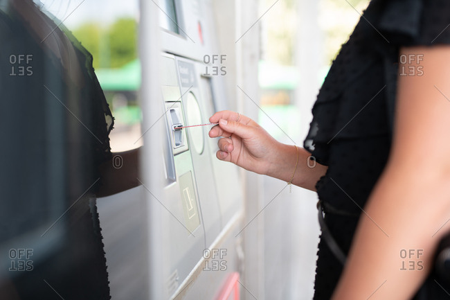 Closeup of woman paying with card at outdoor teller