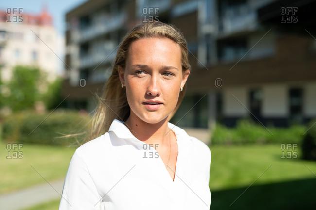 Closeup outdoor portrait of blonde business woman