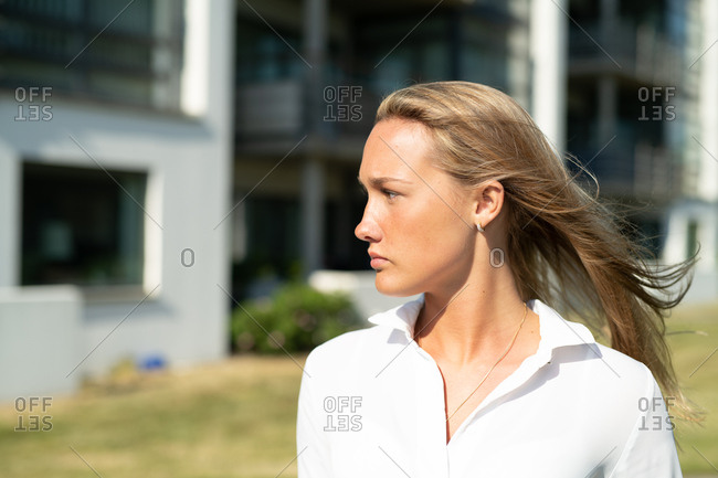 Serious woman looking to side in bright sunlight