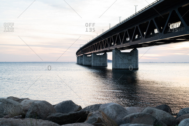View of curved bridge over body of water