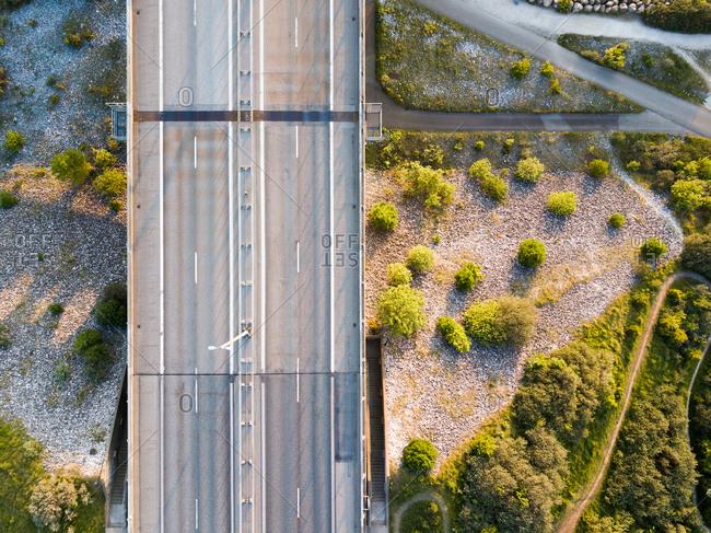 Drone view of empty bridge lanes at golden hour