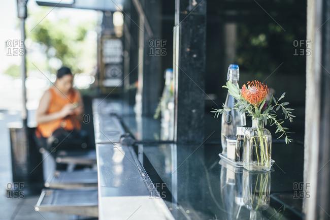 Glass bottles on outdoor restaurant bar