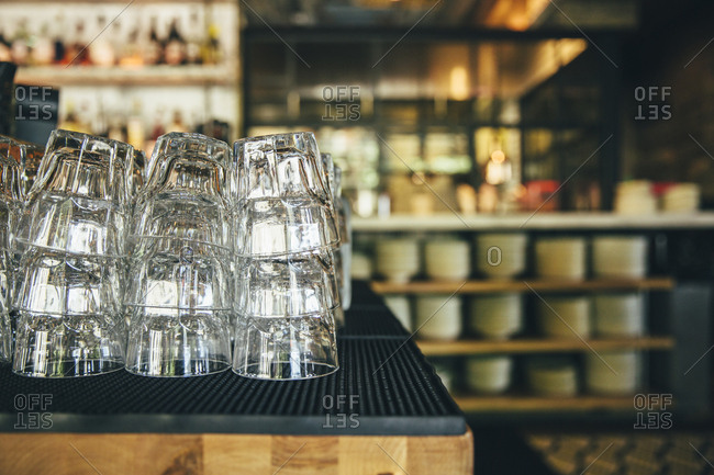 Closeup of stacked restaurant glasses at beverage station