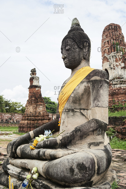 Side view of Buddha statue in ruins of Ayutthaya, Thailand