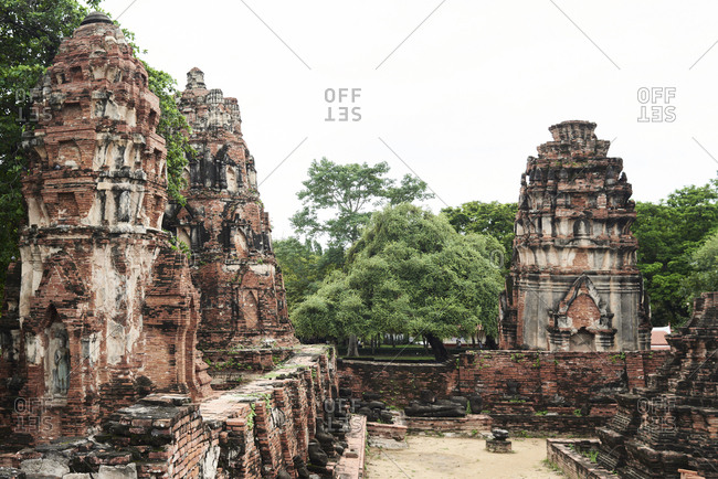 Ruins of Ayutthaya against overcast day time, Thailand