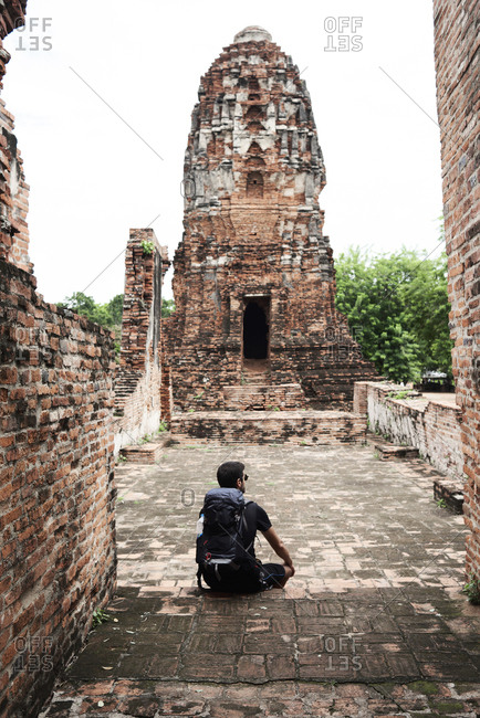 Backpacker enjoying ancient ruins in Ayutthaya, Thailand