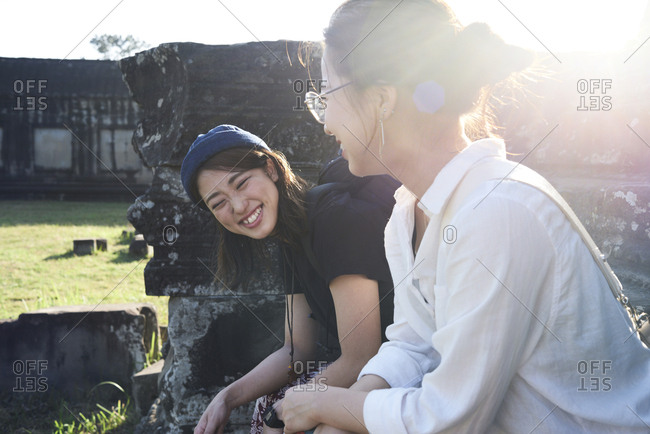 Friends contemplating an ancient temple while traveling together, Angkor Wat, Cambodia