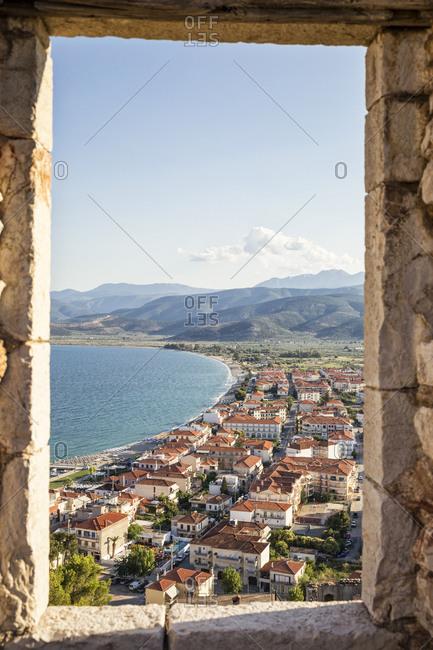 Peloponnese, Greece - June 22, 2017: View on Paralia Astros through castle window