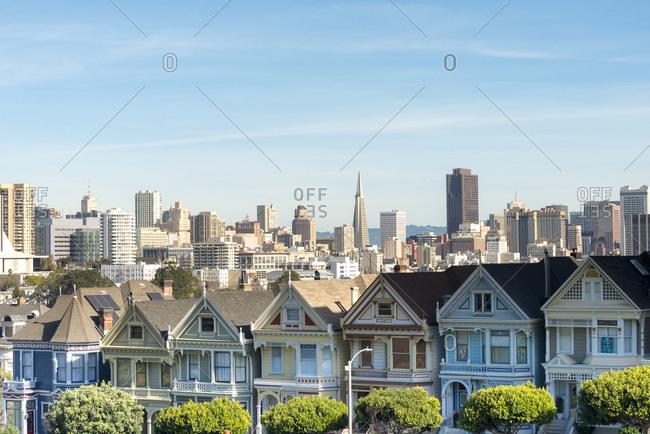 San Francisco, CA, USA - January 27, 2018: Painted Ladies- Victorian houses at Alamo Square and San Francisco Skyline with Transamerica Pyramid