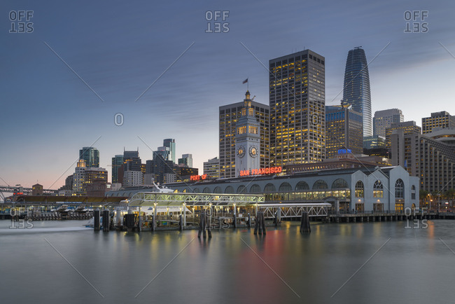 San Francisco, CA, USA - January 27, 2018: Ferry house and Financial District in the evening