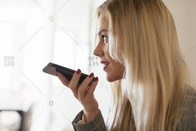 Blond businesswoman talking into phone
