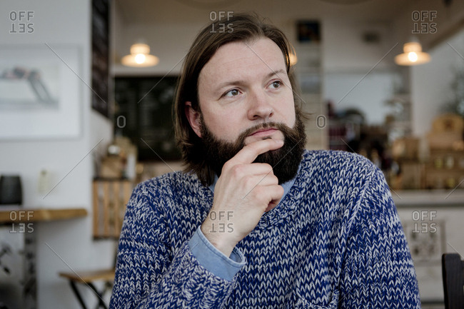 Man with beard sitting in cafe- portrait