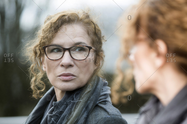 Portrait of mature woman- pensive- mirror image