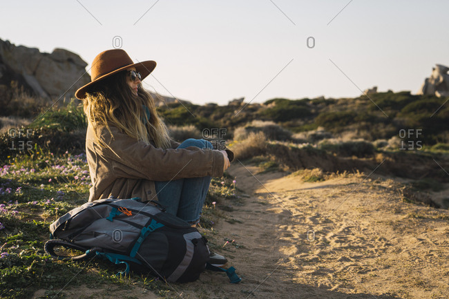 Italy- Sardinia- woman on a hiking trip having a break